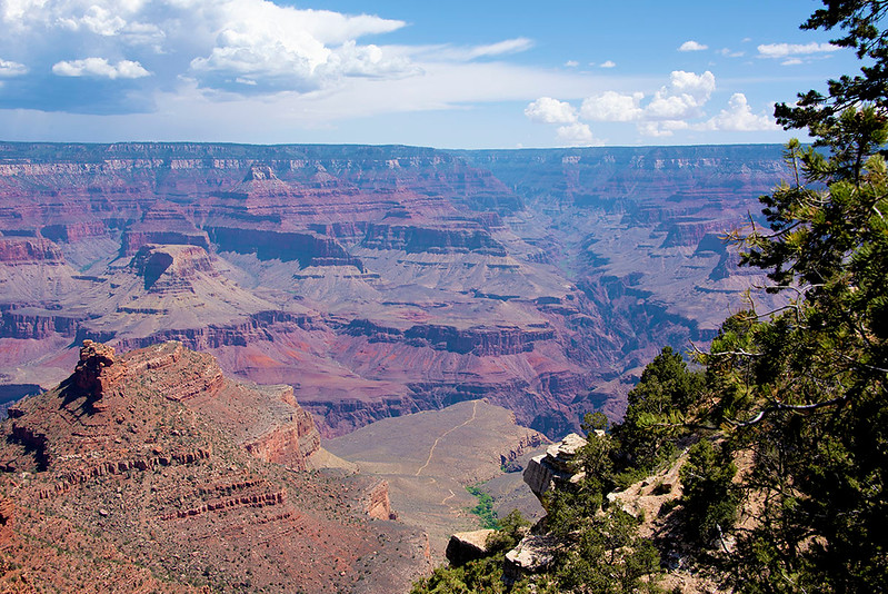 The Grand Canyon is a steep-sided canyon carved by the Colorado River in Arizona, United States. The Grand Canyon is 277 miles long, up to 18 miles wide and attains a depth of over a mile.