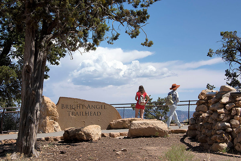 The Bright Angel Trail at the Grand Canyon South Rim is the most popular of the hiking trails. It is not unusual to have hundreds of hikers on the trail during peak season. The trail head is located just west of Bright Angel Lodge in Grand Canyon Village and begins at the Mule Stone Corral.