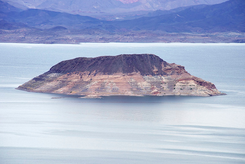 Lake Mead is the largest reservoir in the United States by volume (when it is full). At maximum capacity, Lake Mead is 112 miles long, 532 feet at its greatest depth, has a surface elevation of 1,221.4 feet above sea level and 247 square miles of surface area, and contains 26.12 million acre feet  of water.