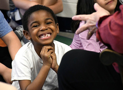 5/1/2018 MIke Orazzi | Staff Eli daniel while listening to storyteller Liz Gruber at the Ivy Drive School in Bristol Tuesday.