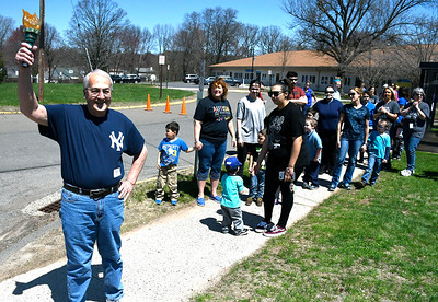 5/1/2018 MIke Orazzi   Staff Vito Montelli holds the torch during the kick off for the senior olympics at the Bristol Senior Center Tuesday.