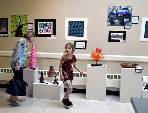 5/1/2018 Mike Orazzi | Staff Sue Ireland and her daughter Elaina Martel,7, admire some of the artwork on display during the Community Art Show held at the Bristol Board of Education Tuesday evening.
