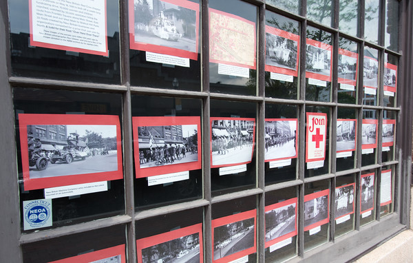 05/07/18 Wesley Bunnell | Staff The New Britain Industrial Museum is making the centennial of New Britain's Red Cross Parade featuring a sidewalk gallery in the museum's windows featuring photos of the parade taken by local photographer Paul Glaeser.