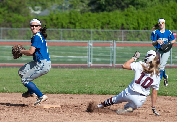 05/21/18 Wesley Bunnell | Staff Bristol Eastern softball defeated Bristol Central on Monday afternoon at Bristol Central High School. Taylor Keegan (6) forces Peyton Greger (10) at second and pivots to throw to first.