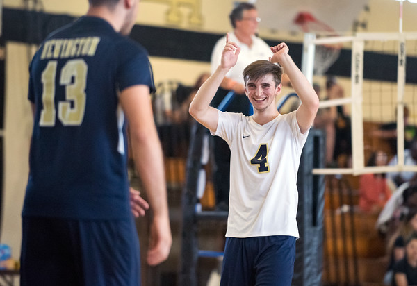 05/23/18 Wesley Bunnell | Staff Newington volleyball defeated East Hartford in a semi final CCC Tournament game at East Hartford on Wednesday evening. Collin Liedke (4) celebrates a point with Leonel Caceres (13).