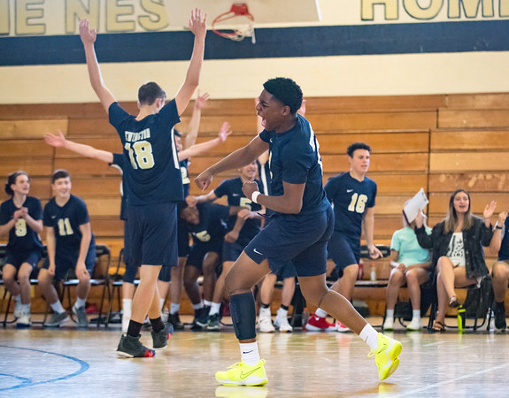 05/23/18 Wesley Bunnell | Staff Newington volleyball defeated East Hartford in a semi final CCC Tournament game at East Hartford on Wednesday evening. Louis Egbuna (2) is fired up in front of the bench after the winning point.