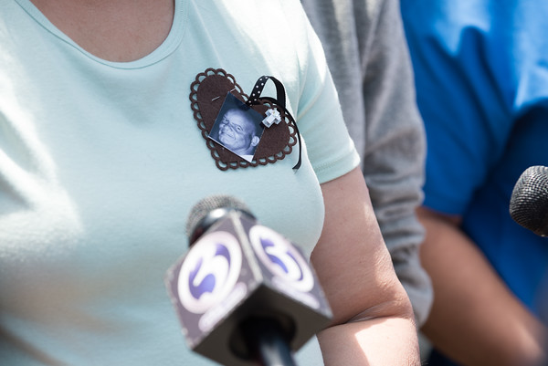 05/23/18 Wesley Bunnell | Staff A photo of Angel &quote;Kiki&quote; Colon, is worn by his sister Alexandra Torres as she speaks to the media outside of New Britain Superior Court on Wednesday afternoon. Jonathan Rafael Soto , 22, of Convoy Drive was arraigned in court for the fatal hit-and-run death of Angel &quote;Kiki&quote; Colon who was struck by a car that fled last Saturday afternoon.