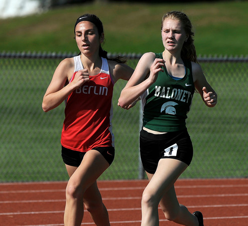 5/23/2018 Mike Orazzi | Staff Berlin High School's Juliana Cancellieri and Maloney's Morgan Kicklighter in the girls 1600 meter during the CCC Track & Field Championships held at Bristol Eastern High School Wednesday.