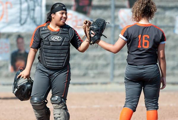 05/23/18 Wesley Bunnell | Staff Goodwin Tech softball vs Canton on Senior Day on Wednesday afternoon. Catcher Teresa Lopez (14) bumps gloves with starting pitcher Valerie Ramirez (16).