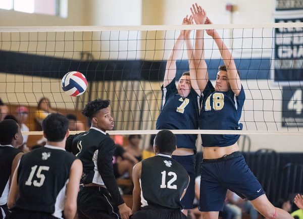 05/23/18 Wesley Bunnell | Staff Newington volleyball defeated East Hartford in a semi final CCC Tournament game at East Hartford on Wednesday evening. Daniel Cloutier (7) and Teddy Fravel (18).