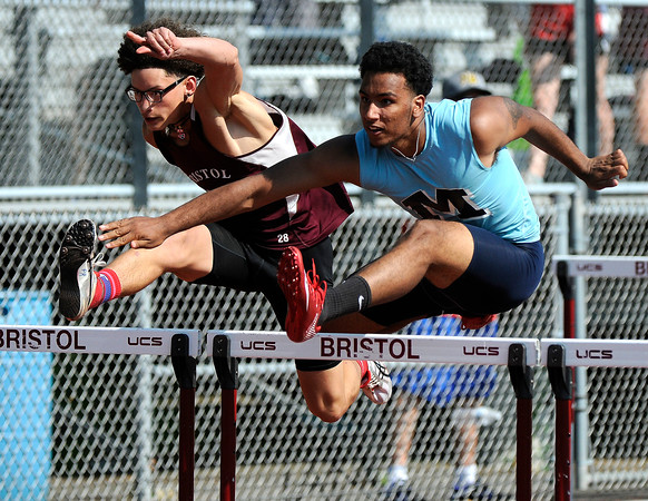 5/23/2018 Mike Orazzi | Staff Bristol Central High School's Jose Navedo and Middletown High School Jaymin Torres during the CCC Track & Field Championships held at Bristol Eastern High School Wednesday.