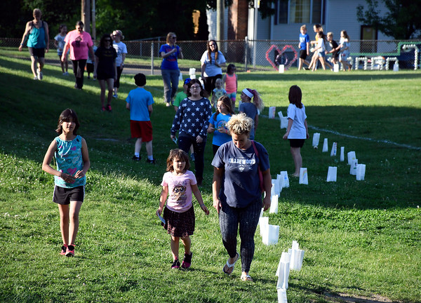 5/23/2018 Mike Orazzi | Staff Participants in the 2nd Annual South Side School Warrior Walk Wednesday evening in honor of Connor Albert, a student who died of cancer in December.
