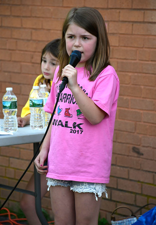 5/23/2018 Mike Orazzi | Staff Olivia Stafford sings the Star Spangled Banner during the 2nd Annual South Side School Warrior Walk Wednesday evening in honor of Connor Albert, a student who died of cancer in December.