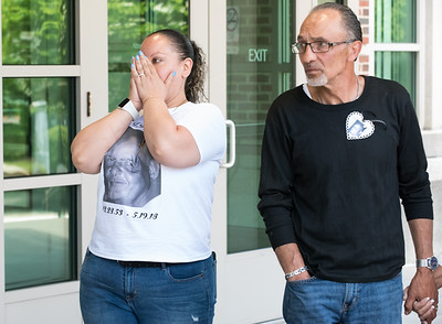 "05/23/18  Wesley Bunnell | Staff  Alexandra Torres, L, wears a t-shirt showing her uncle Angel ""Kiki"" Colon as she waits outside of New Britain Superior Court on Wednesday afternoon along with family members. Jonathan Rafael Soto , 22, of Convoy Drive was arraigned in court for the fatal hit-and-run death of Angel ""Kiki"" Colon who was struck by a car that fled last Saturday afternoon."
