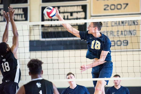 05/23/18 Wesley Bunnell | Staff Newington volleyball defeated East Hartford in a semi final CCC Tournament game at East Hartford on Wednesday evening. Teddy Fravel (18).