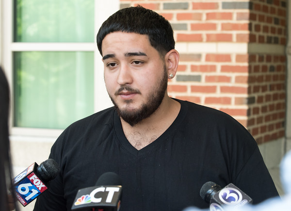 05/23/18 Wesley Bunnell | Staff Angel Ortiz, the brother of Jonathan Rafael Soto, speaks outside of New Britain Superior Court to the media. Jonathan Rafael Soto , 22, of Convoy Drive was arraigned in New Britain Superior Court on Wednesday at noon for the fatal hit-and-run death of Angel &quote;Kiki&quote; Colon who was struck by a car that fled last Saturday afternoon.