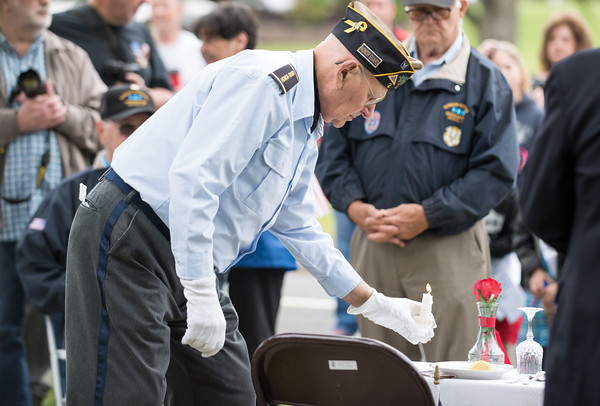 05/28/18 Wesley Bunnell | Staff Bristol held its second Memorial Day Parade on Monday morning starting near Race & North Main St and ending on Memorial Blvd with a ceremony. Veteran Charles Bouffard lights a candle to symbolize hope for the return of all POW/MIA , alive or dead, during a Missing Man Table and Honors Ceremony.