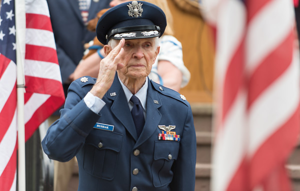 05/28/18 Wesley Bunnell | Staff A packed parade route greeted marchers in the 2018 Memorial Day Parade in Southington on Monday morning. 95 year old Air Force Veteran Walter Hushak salutes as they play the U.S. Air Force Song.