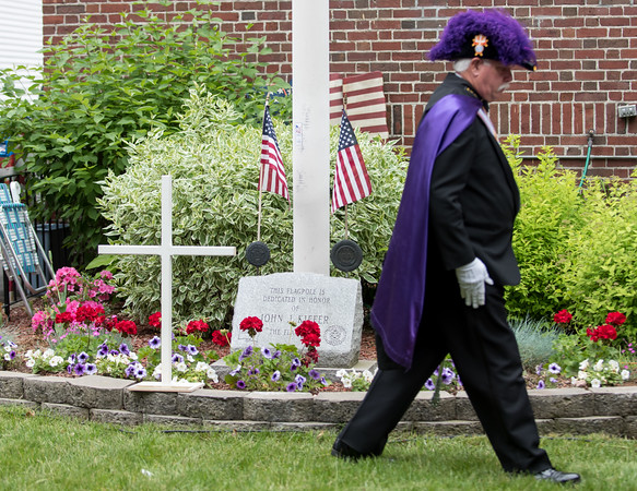 05/28/18 Wesley Bunnell | Staff A packed parade route greeted marchers in the 2018 Memorial Day Parade in Southington on Monday morning. A member of the Knights of Columbus walks away after placing a white cross symbolizing the veterans lost over the last year.