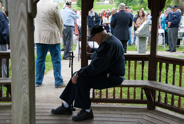 05/28/18 Wesley Bunnell | Staff Bristol held its second Memorial Day Parade on Monday morning starting near Race & North Main St and ending on Memorial Blvd with a ceremony. Korean War Veteran Ed Pelkey sits inside of a gazebo as the ceremony takes place in front.
