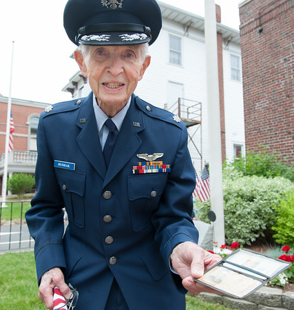 05/28/18 Wesley Bunnell | Staff A packed parade route greeted marchers in the 2018 Memorial Day Parade in Southington on Monday morning. 95 year old Air Force Veteran Walter Hushak holds his ID originally issued on Nov 2, 1944. d