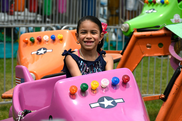 5/26/2018 Mike Orazzi | Staff Neychaeri Gonzlez rides the rides while at the United Way carnival held on Memorial Blvd. in Bristol Saturday.