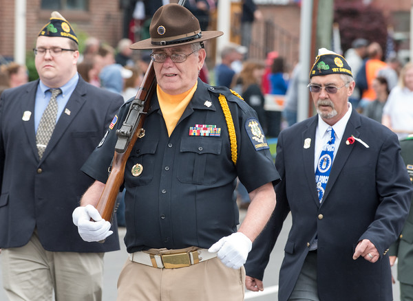 05/28/18 Wesley Bunnell | Staff A packed parade route greeted marchers in the 2018 Memorial Day Parade in Southington on Monday morning. Past Commander of Post 72 Steve McCarty marches down Main St.