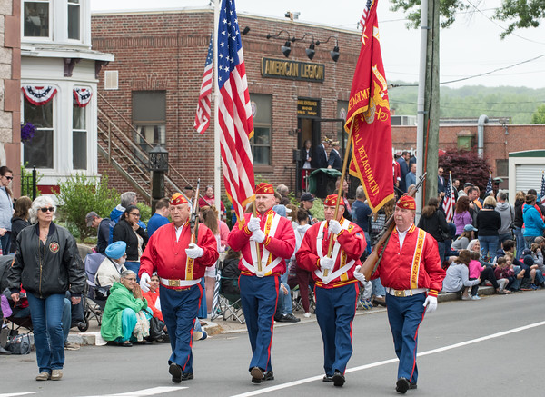 05/28/18 Wesley Bunnell | Staff A packed parade route greeted marchers in the 2018 Memorial Day Parade in Southington on Monday morning. Members of the Marine Corps League march down the parade route in front of the American Legion Post 72 on Main St.