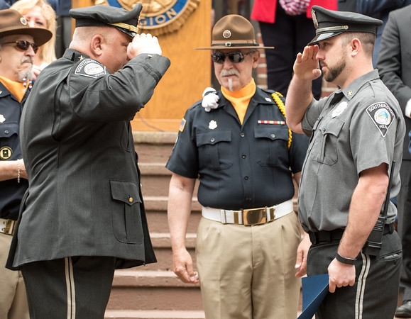 05/28/18 Wesley Bunnell | Staff A packed parade route greeted marchers in the 2018 Memorial Day Parade in Southington on Monday morning. Southington police officer Justin Simaro, R, salutes Deputy Chief Palmieri after receiving the Officer of the Year award from the American Legion Post.