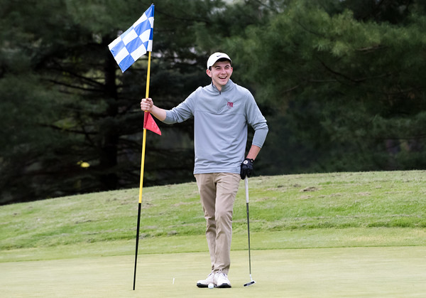 05/10/18 Wesley Bunnell | Staff New Britain golf defeated Bristol Eastern 212-219 at Stanley Golf Course on Thursday afternoon. New Britain's Tim Carrier enjoys a laugh while tending to the flag.