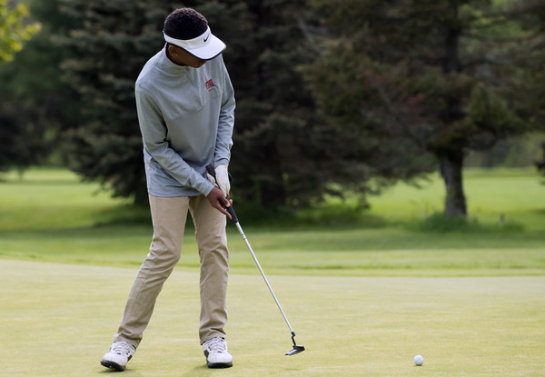 05/10/18 Wesley Bunnell | Staff New Britain golf defeated Bristol Eastern 212-219 at Stanley Golf Course on Thursday afternoon. New Britain's Dylan Washington makes a tough putt.