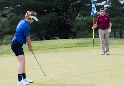 05/10/18  Wesley Bunnell | Staff  New Britain golf defeated Bristol Eastern 212-219 at Stanley Golf Course on Thursday afternoon. Bristol Eastern's Olivia Beaudoin putts as New Britain's Arthur Bell tends the flag.