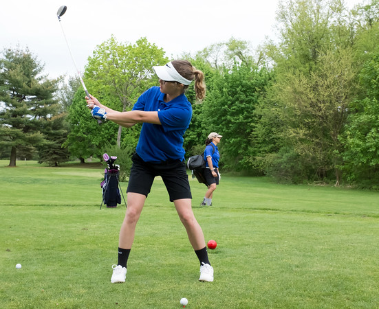 05/10/18 Wesley Bunnell | Staff New Britain golf defeated Bristol Eastern 212-219 at Stanley Golf Course on Thursday afternoon. Bristol Eastern's Olivia Beaudoin checks her swing.