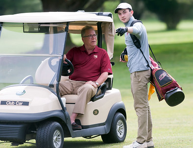 05/10/18  Wesley Bunnell | Staff  New Britain golf defeated Bristol Eastern 212-219 at Stanley Golf Course on Thursday afternoon.  New Britain's Tim Carrier speaks with Coach Bob Zadrozny.