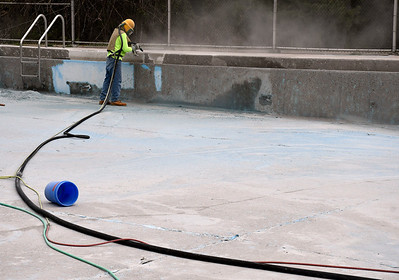 5/10/2018 Mike Orazzi | Staff The city pool at Page Park in Bristol is being sand blasted in order to prepare it for the summer swimming season.