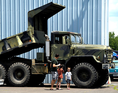 6/10/2017 Mike Orazzi | Staff Michael Casinghino and his sons Ethan and Collin admire a military dump truck on display during the Wings and Wheels Festival at Robertson Airport in Plainville Saturday.