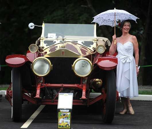 6/17/2017 Mike Orazzi | Staff Jane Kelley-Sabatino poses next to a 1921 Rolls Royce Silver Ghost on display during the Klingberg Vintage Motorcar Festival in New Britain Saturday morning.