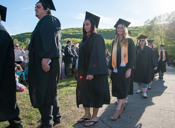 05/11/18 Wesley Bunnell | Staff Lincoln College of New England held their Fifty-first Annual Commencement Ceremony on Friday evening on the college campus. Students look over their shoulders at family and friends as they march to their seats including Hayley Baker, 3rd R, and April Wisneski.