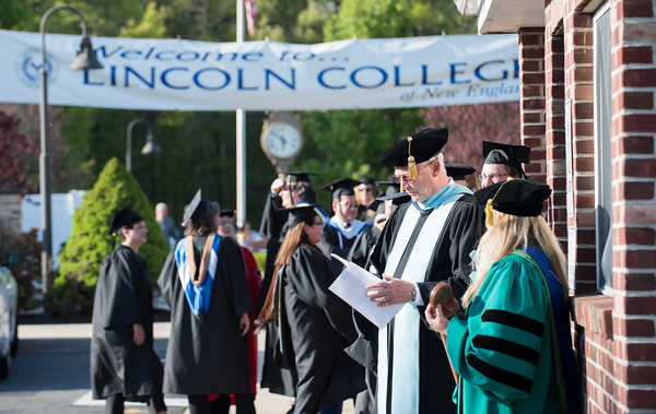 05/11/18 Wesley Bunnell | Staff Lincoln College of New England held their Fifty-first Annual Commencement Ceremony on Friday evening on the college campus. President Jim Vernon goes over his remarks while waiting for commencement to start.