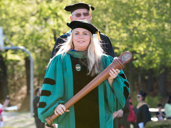 05/11/18 Wesley Bunnell | Staff Lincoln College of New England held their Fifty-first Annual Commencement Ceremony on Friday evening on the college campus. Grand Marshall Nicole Kras, Program Director of Human Services, leads the procession past family and friends.