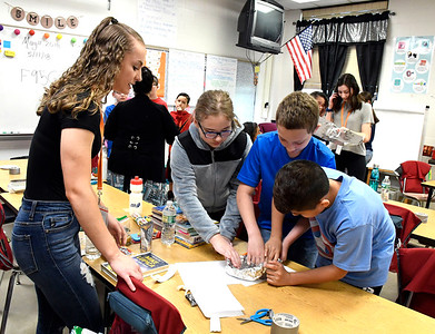 5/11/2018 Mike Orazzi | Staff Bristol Eastern High School student Rebecca Bender works with South Side School students Haley Kovith, Darrek Griffith and Rafael Antonio during a Science, Technology, Engineering, Art, Math held Friday morning.