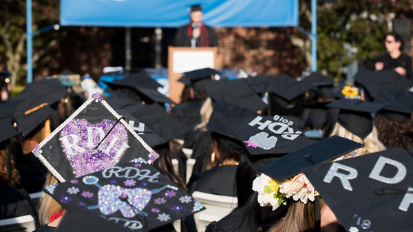 05/11/18 Wesley Bunnell | Staff Lincoln College of New England held their Fifty-first Annual Commencement Ceremony on Friday evening on the college campus. Classmates with mortar boards from Registered Dental Hygienists sit together as graduate Nicholas Theroux gives the Valedictory Address.