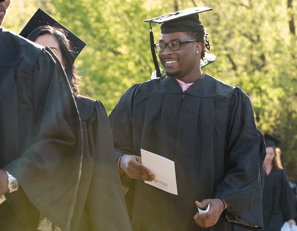 05/11/18 Wesley Bunnell | Staff Lincoln College of New England held their Fifty-first Annual Commencement Ceremony on Friday evening on the college campus. Students smile at family and friends as they march to their seats.