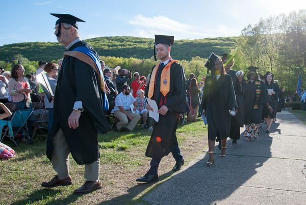 05/11/18 Wesley Bunnell | Staff Lincoln College of New England held their Fifty-first Annual Commencement Ceremony on Friday evening on the college campus. The procession of students marches past family and friends.