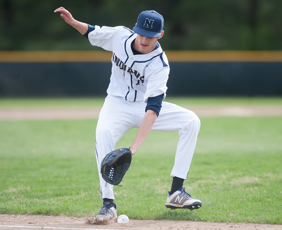 05/11/18 Wesley Bunnell | Staff Newington baseball vs Hall on Friday afternoon at Newington High School. Pitcher Josh LeClair (15) straddles a ball down the line letting it roll foul before picking it up.