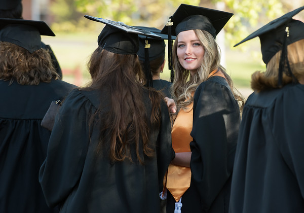 05/11/18 Wesley Bunnell | Staff Lincoln College of New England held their Fifty-first Annual Commencement Ceremony on Friday evening on the college campus. Hayley Baker looks at fellow students in line as they await the start of commencement.