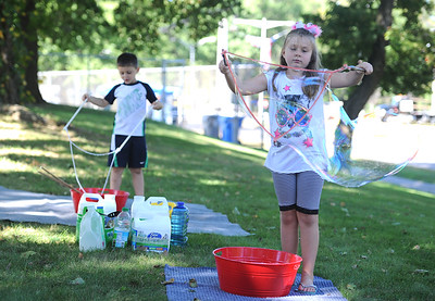 9/23/2017 Mike Orazzi | Staff Nathan and Emma Johnson make giant bubbles in the Kids Zone during the 56th Annual Chrysanthemum Festival on Saturday in Bristol