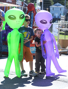 9/23/2017 Mike Orazzi | Staff Aiden and Jacob Sullivan with giant aliens during the 56th Annual Chrysanthemum Festival on Saturday in Bristol.