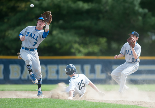 05/11/18 Wesley Bunnell | Staff Newington baseball vs Hall on Friday afternoon at Newington High School. The Hall short leaps for the ball but Ethan Erbera (25) has his 15th steal of the season.