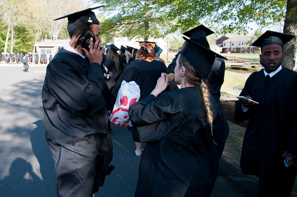 05/11/18 Wesley Bunnell | Staff Lincoln College of New England held their Fifty-first Annual Commencement Ceremony on Friday evening on the college campus. Terrance Newman, L, shares his Chick-fil-a with fellow graduates as they wait for commencement to start.